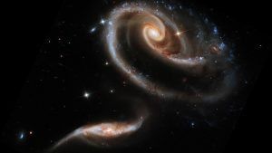 The larger galaxy in the UGC 1810 - UGC 1813 pair has a mass that is about five times that of the smaller galaxy. Both are so vast. How are we connected? You and I?