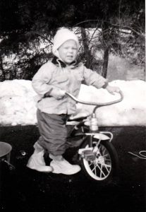 James Carvin with his brand new tricycle, Christmas 1961.